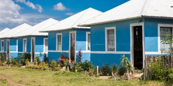 Row of blue Habitat houses, Philippines