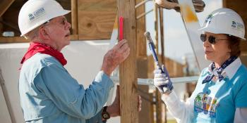 Jimmy and Rosalynn Carter building with Habitat.