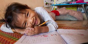 Girl doing homework, A habitat for learning, Habitat for Humanity