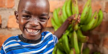 Young child with bananas, Kenya
