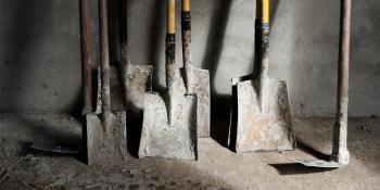 Shovels leaning against a wall