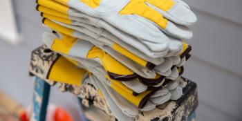 Why volunteer? Habitat for Humanity stack of work gloves