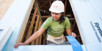 AmeriCorps ServiceFeed, Valerie Nguyen installs a window during the annual Habitat AmeriCorps Build-a-Thon