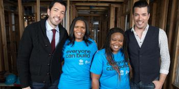 Jonathan and Drew Scott in a partially built house with future homeowners Ashlee and Amanda.