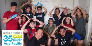 Thomas Lim (front, right) with Project HomeWorks volunteers after cleaning up a home in Singapore.