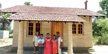 The first family who built their home with compressed stabilized earth blocks in Habitat Sri Lanka's EU project