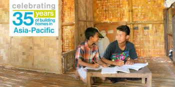Phon Pyae Han (right), 15, and Pyae Sone Maung, 9, live in a Habitat bamboo home in Myanmar
