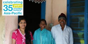 Malan (center) with her daughter Surekha (left) and husband Moreshwar (right) in front of their Habitat home built during 2006 Carter Work Project in Lonavala, India.