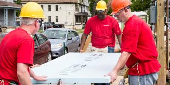 KeyBank volunteers on a build site.