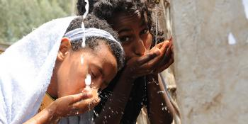 Photo: Children drinking water from a water point in Ethiopia