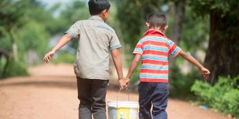 Cambodian kids carrying water