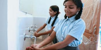 Students in India washing their hands