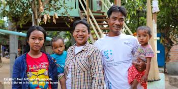 Eat (third from left) and her husband Phlonh and their children in front of their home completed during Cambodia Big Build 2019.