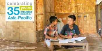 Phon Pyae Han (far right) and his younger brother Pyae Sone Maung at their Habitat home in Myanmar. Photo: Habitat for Humanity/ Ritwik Sawant.