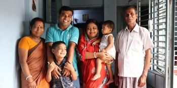 Ashish with his parents, wife and children in their Habitat home in Bangladesh