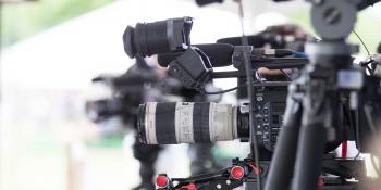 focus on press cameras with blurred background.