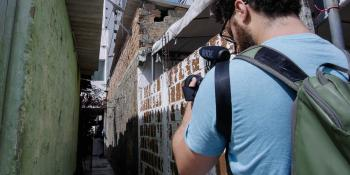 Photo: a cameraman shooting a narrow street
