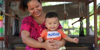 Cambodian homeowner Senghouch with her son in Kandal province