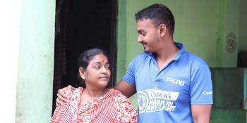 Lalita and her son Biddut outside their home in Mymensingh, Bangladesh.