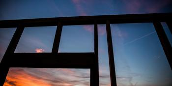 A silhouette of a wall on a build site.