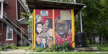 Photo of a colorful mural depicting diverse residents of a community.