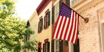 American flag hanging from townhome.