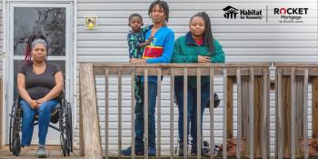 Wheelchair-using mother and her children on the porch of their accessible Habitat home.