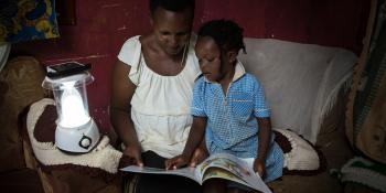 Photo: Mother and daughter reading a book together, Uganda