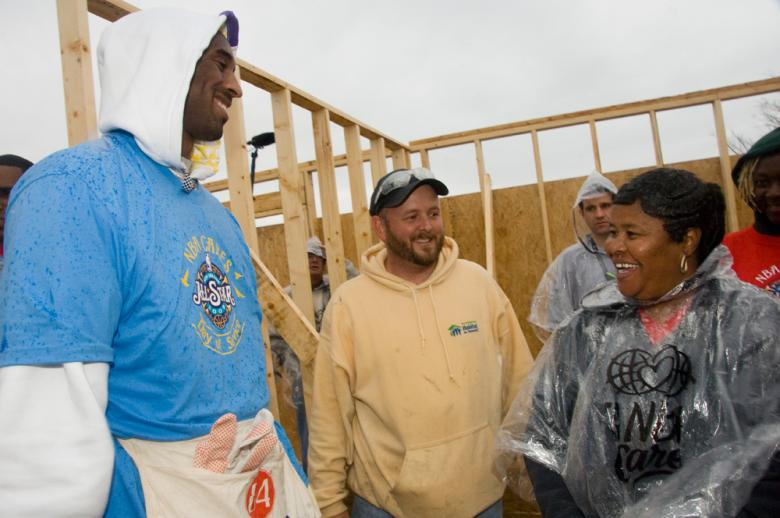 Scott Pointer, Kobe Bryant, and future homeowner on Build-a-Thon build site
