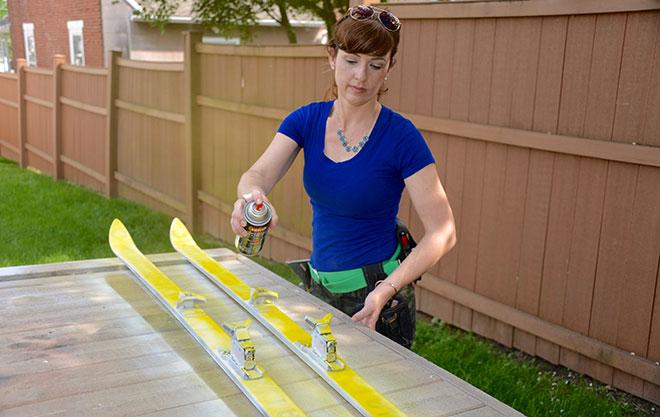 Spray paint skis for DIY tiki torch