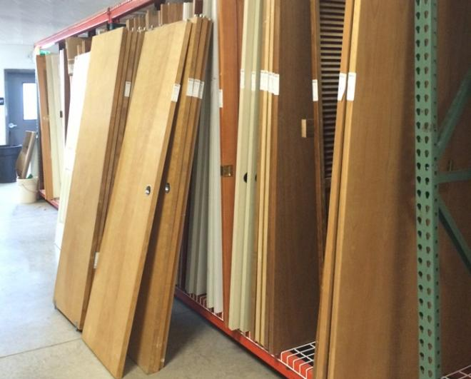 Stack of doors & An upcycled art show benefits a reopened Habitat ReStore