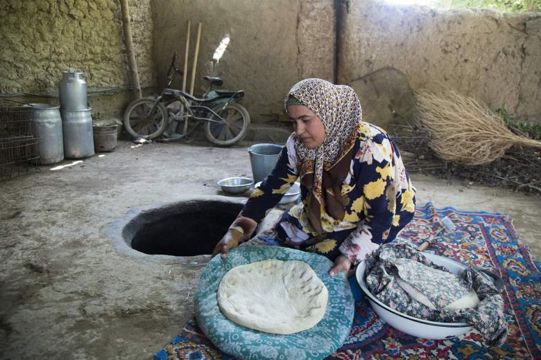 woman preparing food in Tajikistan