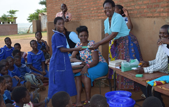 Schoolgirls-receiving-prizes-after-quiz-was-conducted-on-sanitation-and-hygiene