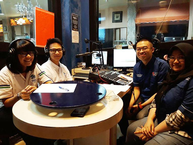 Habitat Indonesia youth volunteers at a radio show.
