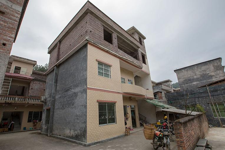 Zhimin would like to complete construction on the third story to provide more room for his daughters.