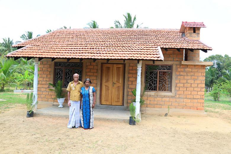 Nadarasa and his wife Yogeswary outside their new house.