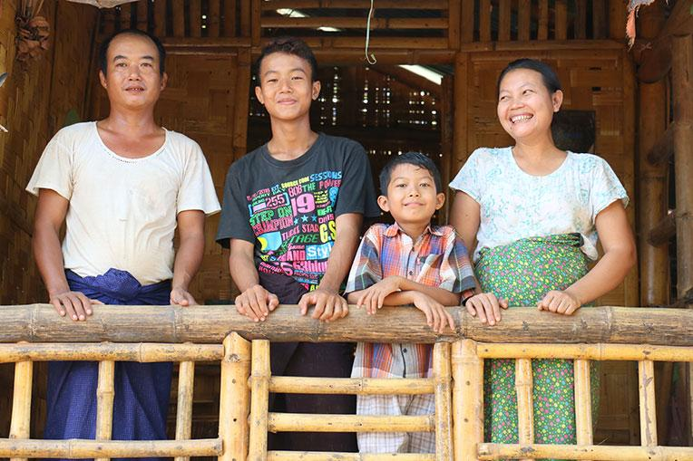U Aung Aung Oo and his family on the veranda of their Habitat home in Myanmar