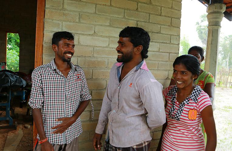 Head mason Sasikaran Thangavel (left) and the family with whom he build a CSEB house.