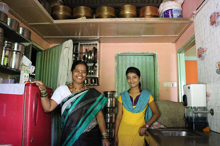 Jayshri and her daughter Komal inside their Habitat home in Lonavala, India, in 2016.