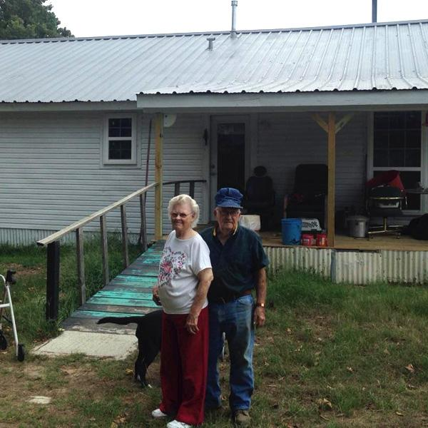 Arlett and Ruby standing in front of their home.