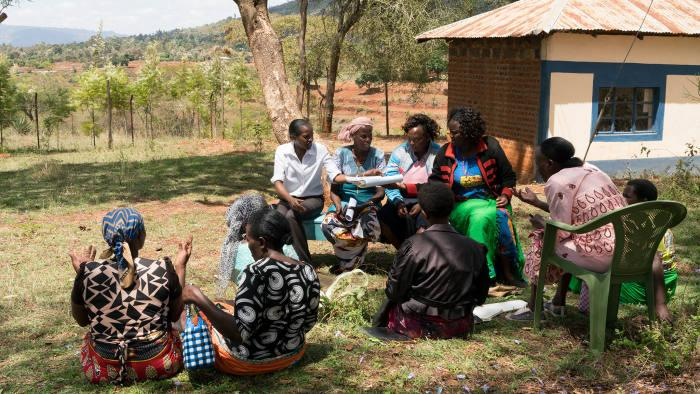 A women's group discusses loans under the guidance of a KWFT officer in Kyangala, Kenya