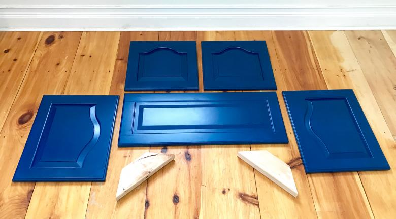 Five cabinet doors painted blue.