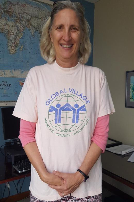 "Karen Foreman wearing a T-shirt that says. ""Global Village, Habitat for Humanity International."""