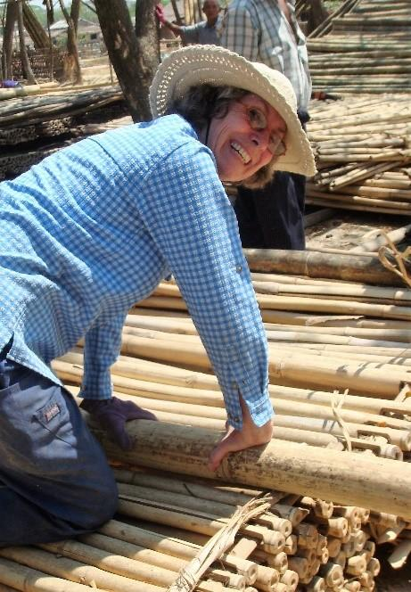 Val laying down wooden beams.