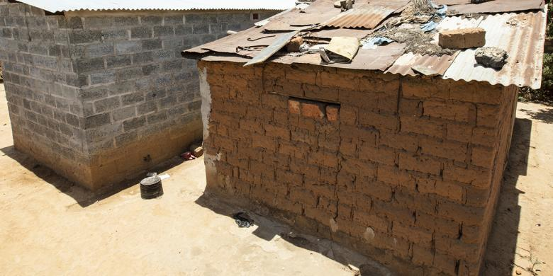Photo: two structures - one from cement block and one from mud bricks