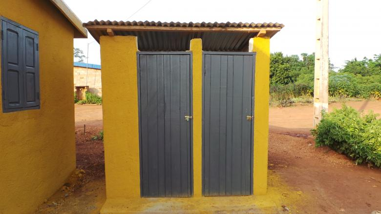 Photo: two ventilated latrines next to a house, Dida-Yaokro, Cote d'Ivoire
