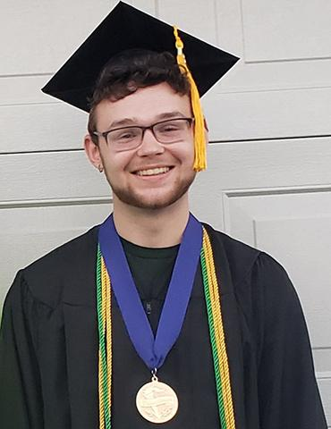 Christina's son Joseph in his graduation cap and gown.